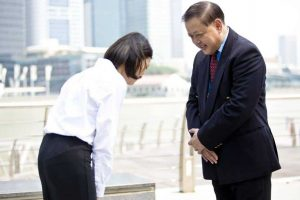 38830747 – asian businessman and young female executive bowing